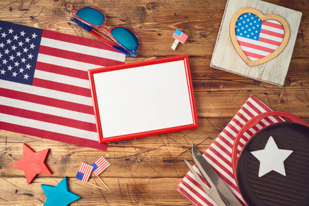Happy Independence Day, 4th of July celebration concept with frame, USA flag and barbeque grill  on wooden background. Top view from above 版權商用圖片