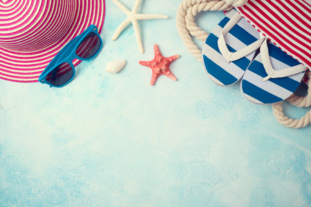 Summer holiday vacation background with beach accessories. Top view from above