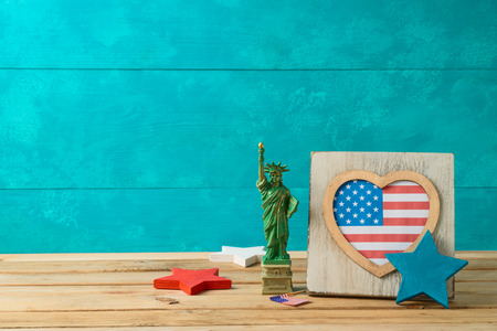Happy Independence Day, 4th of July celebration concept with frame and american flag on wooden table 写真素材