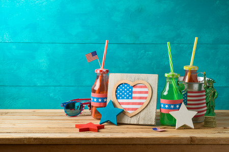Happy Independence Day, 4th of July celebration concept with party drinks and american flag on wooden table