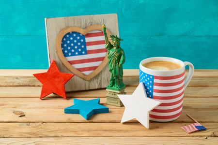 Happy Independence Day, 4th of July celebration concept with coffee cup and american flag on wooden table 写真素材