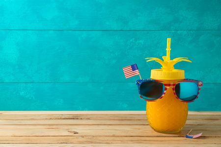 Happy Independence Day, 4th of July celebration concept with funny pineapple jar and sunglasses on wooden table 写真素材
