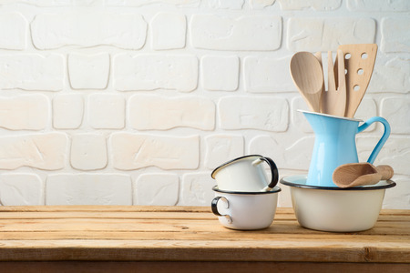 Vintage kitchen utensils and tableware on wooden table
