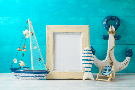 Frame and nautical summer decorations on wooden table 写真素材