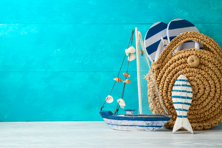 Summer vacation background with nautical decorations and  fashion bag on wooden table 写真素材