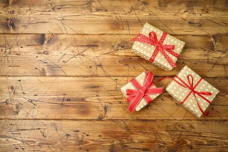 Christmas holiday gift boxes on wooden background. Top view from above Stock Photo