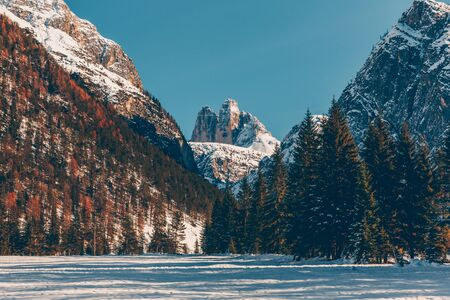 Winter landscape with Dolomites mountains. Travel and tourism concept background.
