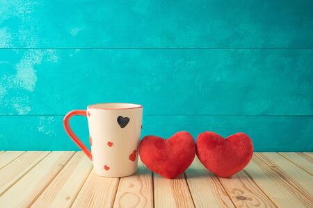 Valentines day concept with coffee cup and heart shapes on wooden table. Archivio Fotografico - 138047767