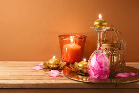 Diwali holiday home decorations on wooden table. 免版税图像