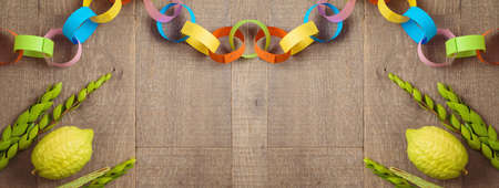 Jewish holiday Sukkot celebration background. Top view from above