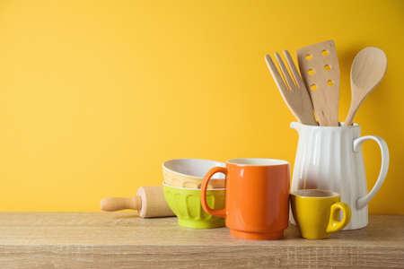 Kitchen utensils and dishware on wooden shelf. Autumn kitchen interior background
