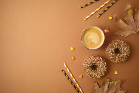 Coffee cup and donuts. Autumn party concept background.