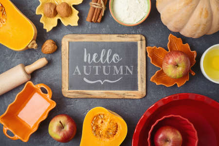 Thanksgiving day and helloo autumn background with chalkboard, apples and pumpkin pie ingredients