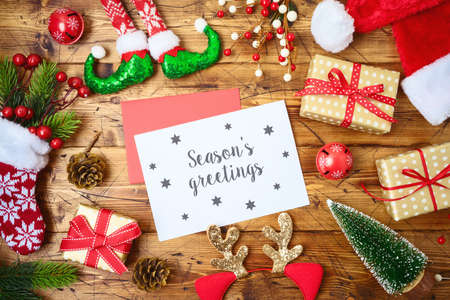 Christmas holiday greeting card or newsletter mock up template with decorations and ornaments on wooden table