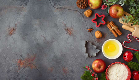 Christmas holiday cooking and baking background with kitchen utensils, iingredients and ornaments. Menu or recipe mock up design 免版税图像