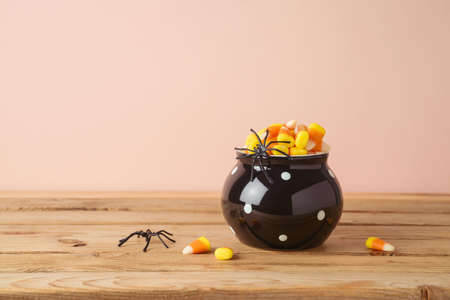 Halloween holiday celebration concept with candy corn  on wooden table