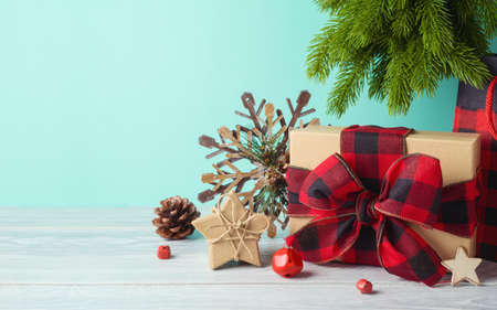 Christmas holiday background with gift box and  ornaments on wooden table. Winter greeting card. 免版税图像