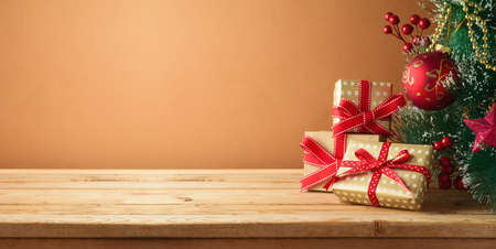Christmas tree and gift boxes on wooden table. Background for product montage display