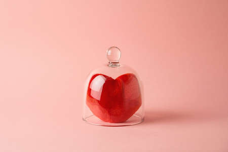 Valentine's day minimal concept with heart shapes under glass protection over pink background 免版税图像
