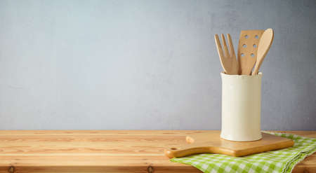 Kitchen utensils and tablelcoth on wooden table. Kitchen interior spring background