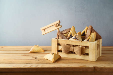 Jewish holiday Purim concept with hamantaschen cookies in wooden box