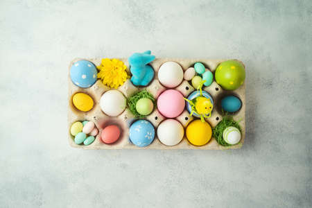 Easter holiday concept with Easter eggs decor on gray background