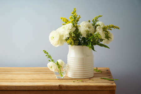 Beautiful spring flower bouquet on wooden table