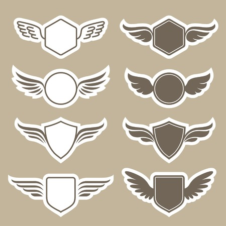 wings icon: Set of retro heraldic shapes with wings in vector