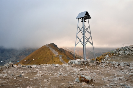 Belfry in mountains. A simple belfry at the top of Kasprowy Wierch in Tatra mountains in Poland.