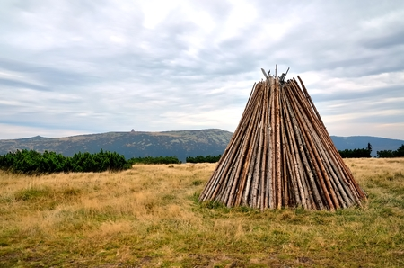 karkonosze: Stack of wood. Logpile piled into a shape of wigwam on a clearing in the Karkonosze mountains. Stock Photo
