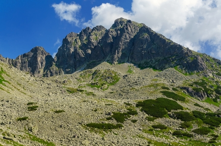 Summer mountain landscape. View over steep and rocky summits in Tatra mountains at sunny day. photo
