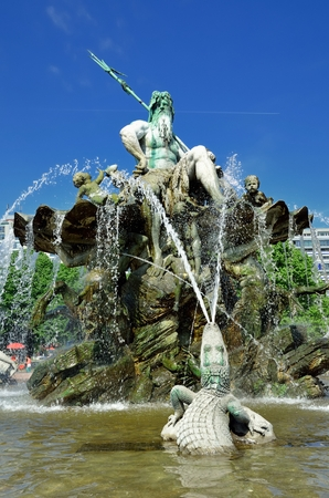 neptun: Part of fountain presenting sculpture of god Neptun at the center and crocodile in the water.