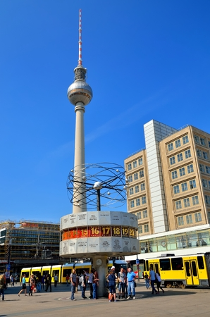 u bahn: BERLIN - April 30, 2014: The World Clock and TV Tower in Berlin. World Clock (Weltzeituhr) and Fernsehturm are situaded on Alexanderplatz, a large square and transport hub, named in honor of a visit of the Russian Emperor Alexander I.