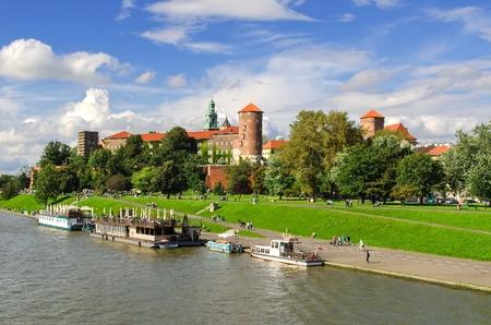 wawel: KRAKOW, POLAND - AUGUST 16, 2014: Wawel Royal Castle in Krakow. Tourist boats on Vistula river with Wawel Royal Castle in the background on sunny summer day, Poland.