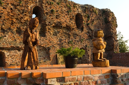 teutonic: Ruins of Teutonic Castle in Torun, Poland, listed by UNESCO organisation. Wooden sculptures in the castle courtyard of the Teutonic Order. Gothic castle now housing a museum.