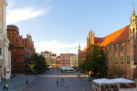 tenement: TORUN, POLAND - SEPTEMBER 17, 2014: Gothic city, the Old Town Square in Torun. Historic tenement houses and part of the Old Town Hall in Torun, listed by UNESCO organisation.