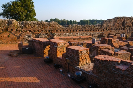 teutonic: TORUN, POLAND - SEPTEMBER 17, 2014: Teutonic Castle in Torun, Poland, listed by UNESCO organisation. Ruins of gothic castle of the Teutonic Order now housing a museum. Editorial