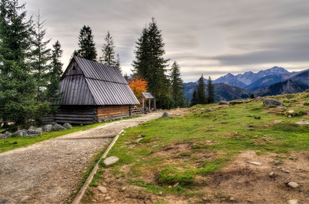 wooden hut: Wooden hut and mountain landscape in Polish Tatra Mountains.