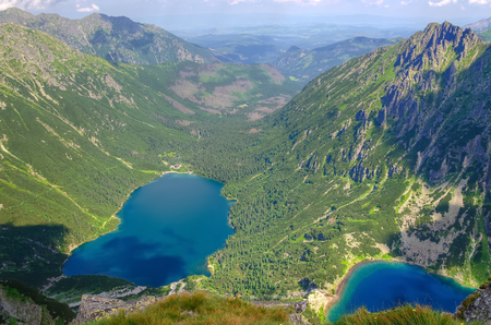 morskie: Two lakes in mountains. Two blue mountain lakes surrounded by high summits. Morskie Oko (Eye of the Sea) and Czarny Staw (BlackPond) are the most popular place in High Tatra Mountains, Poland. Stock Photo