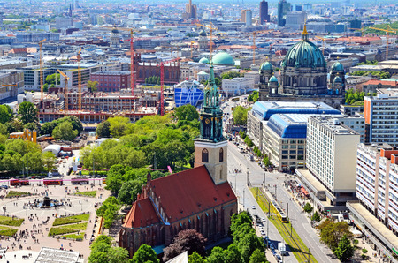 BERLIN, GERMANY - MAY 3, 2014: Aerial view of Berlin. Panorama of Berlin (Neptune fountain, Marienkirche, Berliner Dom) seen from the roof of the hotel Park Inn by Radisson in Alexanderplatz.