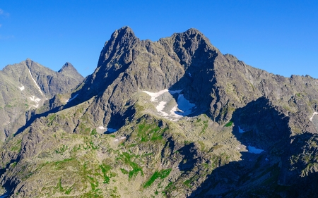 Mountain landscape. Picturesque view stretches over mountain ridge and high rocky summits in Tatras. photo