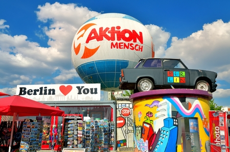 BERLIN, GERMANY - APRIL 30, 2014: Trabant car. Famous Eastern Germany Trabi Car and souvenir shop at Zimmerstrasse in Berlin.