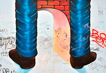 mauer: BERLIN, GERMANY - MAY 2, 2014: The Berlin Wall (Berliner Mauer) in Germany. Colour graffitti on the wall, barrier constructed in 1961, that completely cut off West Berlin from East Berlin, demolished in 1989. Editorial