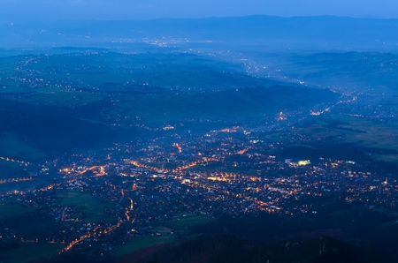 birdeye: Town landscape at night. A birdeye view of a mountain town after sunset Zakopane in Poland.