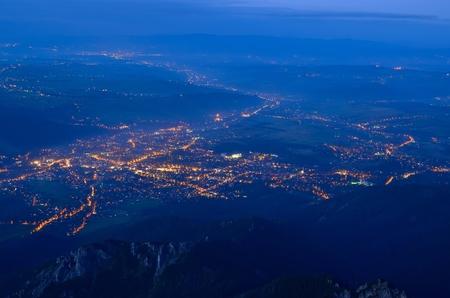 birdeye: Town landscape at night. A birdeye view of a mountain town after sunset Zakopane in Poland.