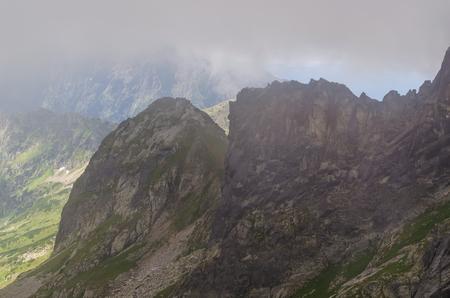 mountainscape: Cloudy mountain landscape. View on mountain peak in clouds Tatra mountains in Poland. Stock Photo