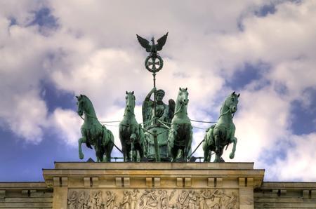 quadriga: The bronze sculpture Quadriga on top of the Brandenburg Gate.