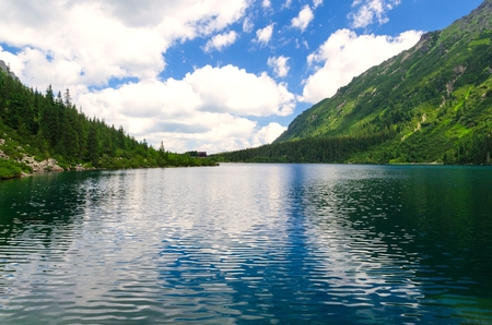 mountainscape: Lake in summer mountains. Picturesque view stretches over the Eye of the Sea Sea Eye Reviews one of the most popular lake in the Tatra mountains Poland.