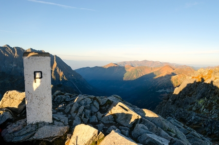 state boundary: Mountain landscape. Border post state boundary between Poland and Slovakia in Tatra mountains.