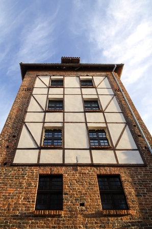 Gothic tower in Torun Poland. Main tower is a relic of medieval city walls surround That the Old Town. Editorial